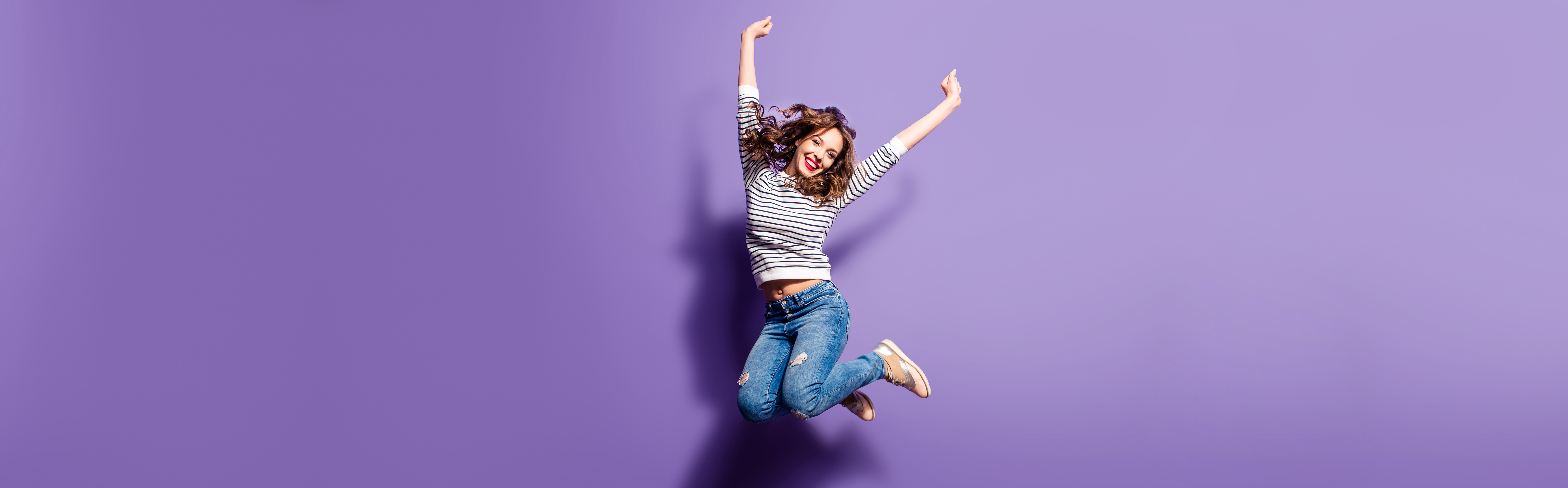 Portrait,Of,Cheerful,Positive,Girl,Jumping,In,The,Air,With